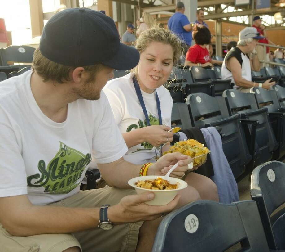 Matt and Carolyn LaWell enjoy some ballpark food May 3, during their stop at CitiBank Ballpark as they tour Minor League Baseball games across the country. Photo by Tim Fischer/Midland Reporter-Telegram Photo: Tim Fischer