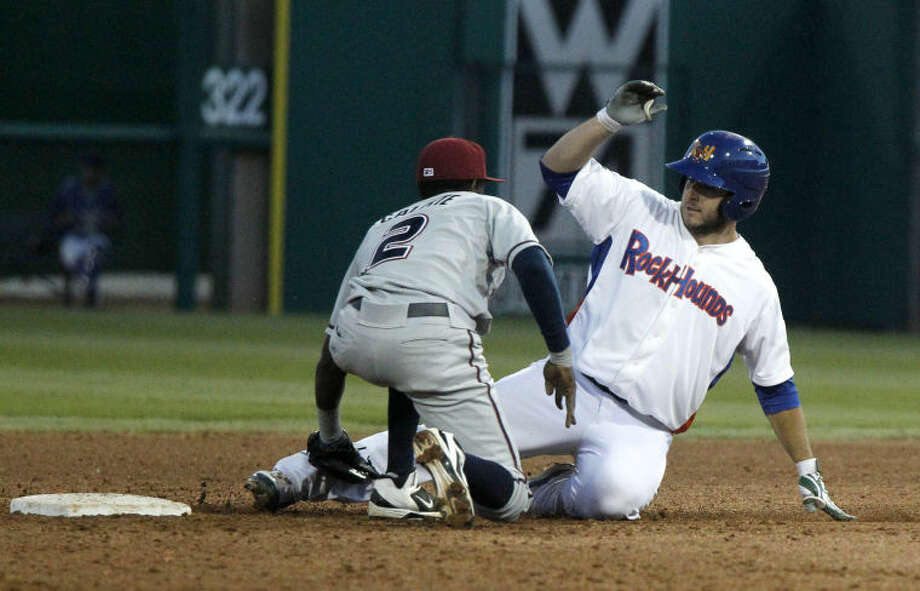 RockHounds' David Freitas is tagged out by Northwest Arkansas second baseman Orlando Calixte Friday at Citibank Ballpark. James Durbin/Reporter-Telegram Photo: JAMES DURBIN