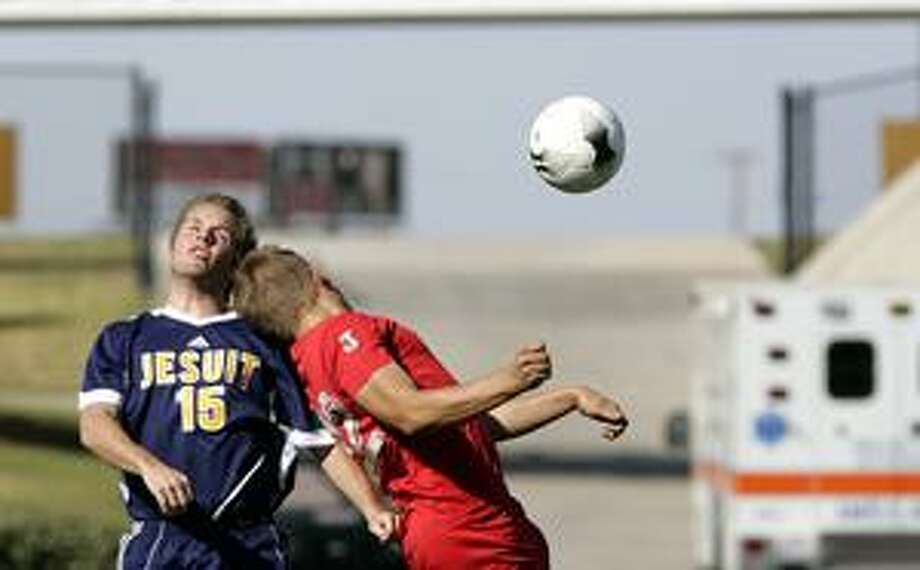 (File Photo) Jesuit College Prep's Andrew Buser and Noclas Thoene of El Paso Bel Air collide as they both jump up for the same header during a regional semifinal match in 2009 at Grande Communications Stadium. The two Region I powers are on opposite sides of the bracket this season and could meet in Saturday's final. photo by Gary Rhodes 04/03/09