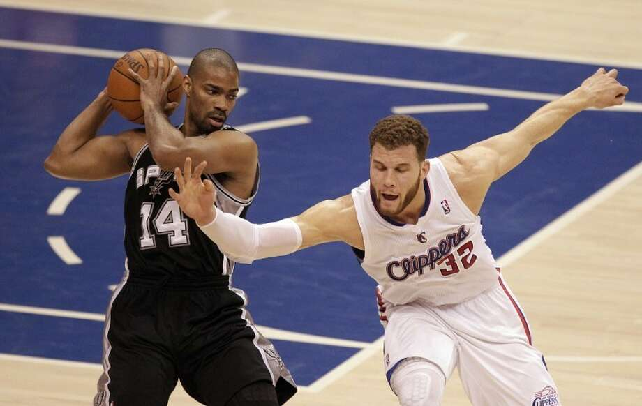 Los Angeles Clippers' Blake Griffin, right, tries to steal the ball from San Antonio Spurs' Gary Neal during the first half in Game 4 of an NBA basketball playoffs Western Conference semifinal game in Los Angeles, Sunday, May 20, 2012. (AP Photo/Jae C. Hong) Photo: Jae C. Hong