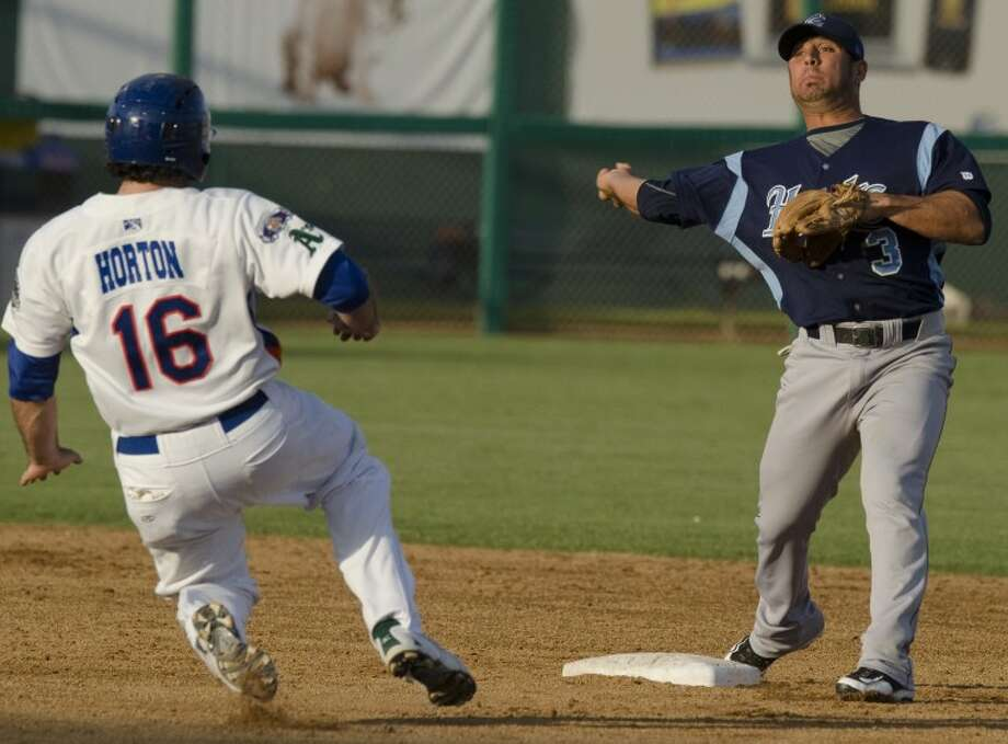 Hooks' Jose Martinez gets the force out at second as Hounds' Josh Horton slides in late, but Martinez is too late to complete the double play at first Monday night at CitiBank Ballpark. Photo by Tim Fischer/Midland Reporter-Telegram Photo: Tim Fischer