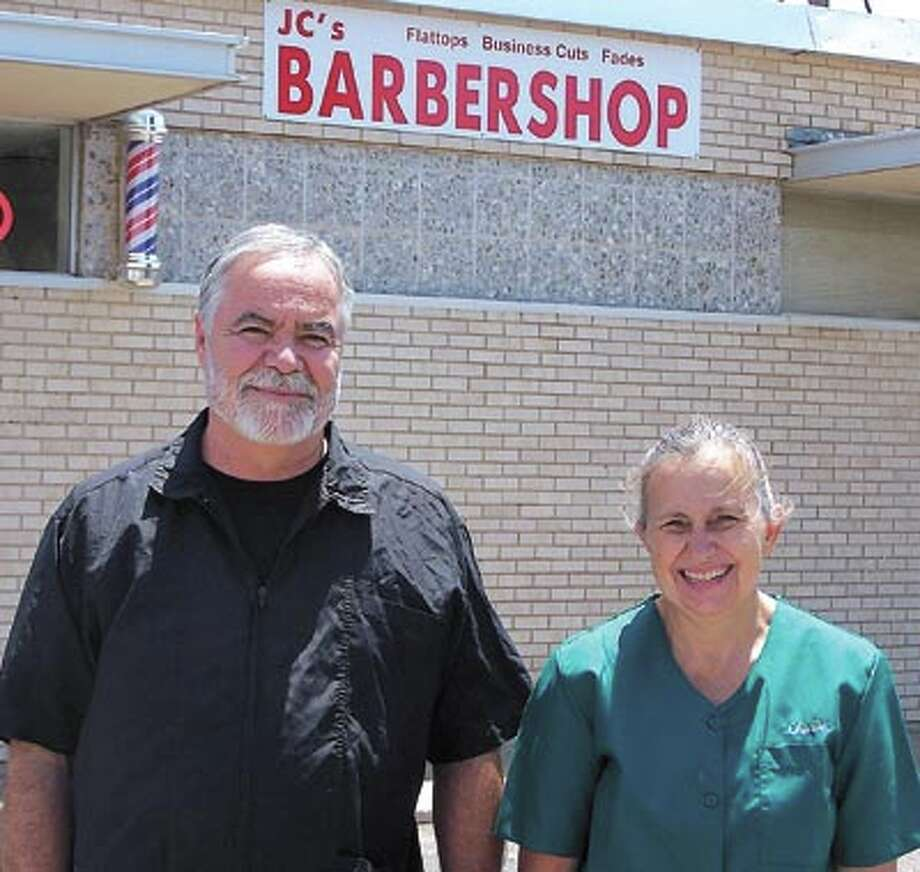 Charlotte (Charlie) Fitzpatrick and John Creek invite you to experience their old-fashioned service at JC's Barbershop on Texas Street, across from St. Ann's School.