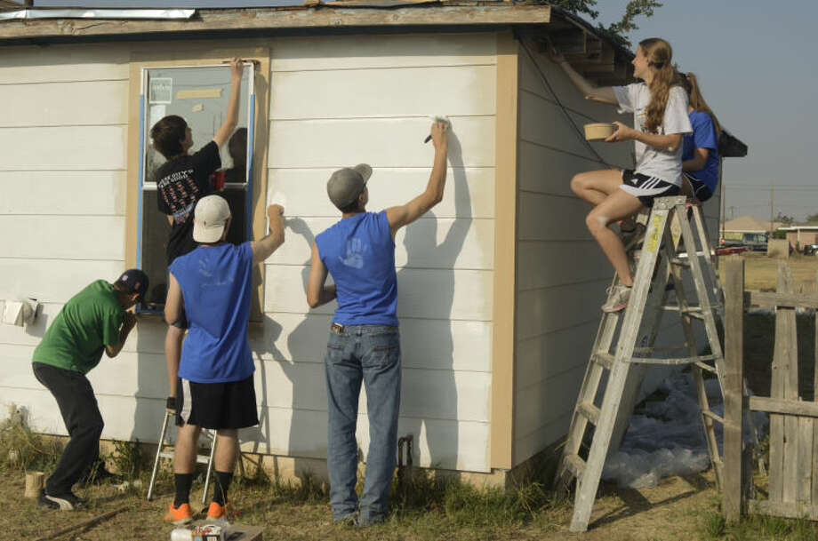 Midland Christian juniors work on a house at 311 S. Lee Wednesday as part of their service day around town. Tim Fischer\Reporter-Telegram 4-17-13 Photo: Tim Fischer