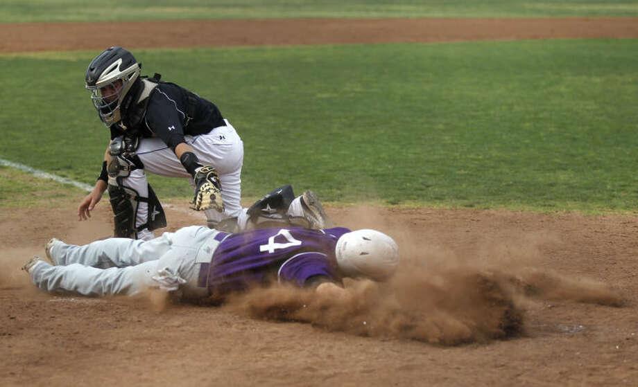 Midland's Connor Beck beats the tag from Abilene Cooper's Garrett Hurst to score Tuesday at Zachery Field. James Durbin/Reporter-Telegram Photo: JAMES DURBIN