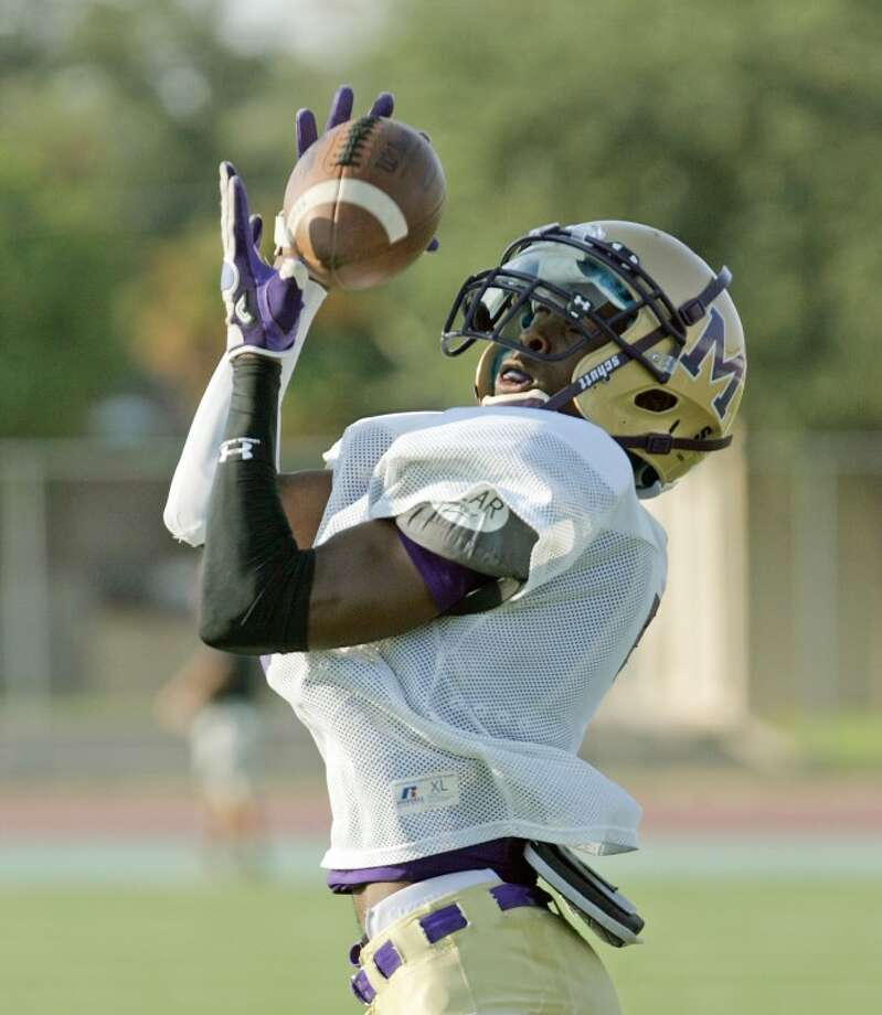 Midland High receiver Donavon Lee catches a pass during practice Wednesday at Memorial Stadium. Cindeka Nealy/Reporter-Telegram Photo: Cindeka Nealy