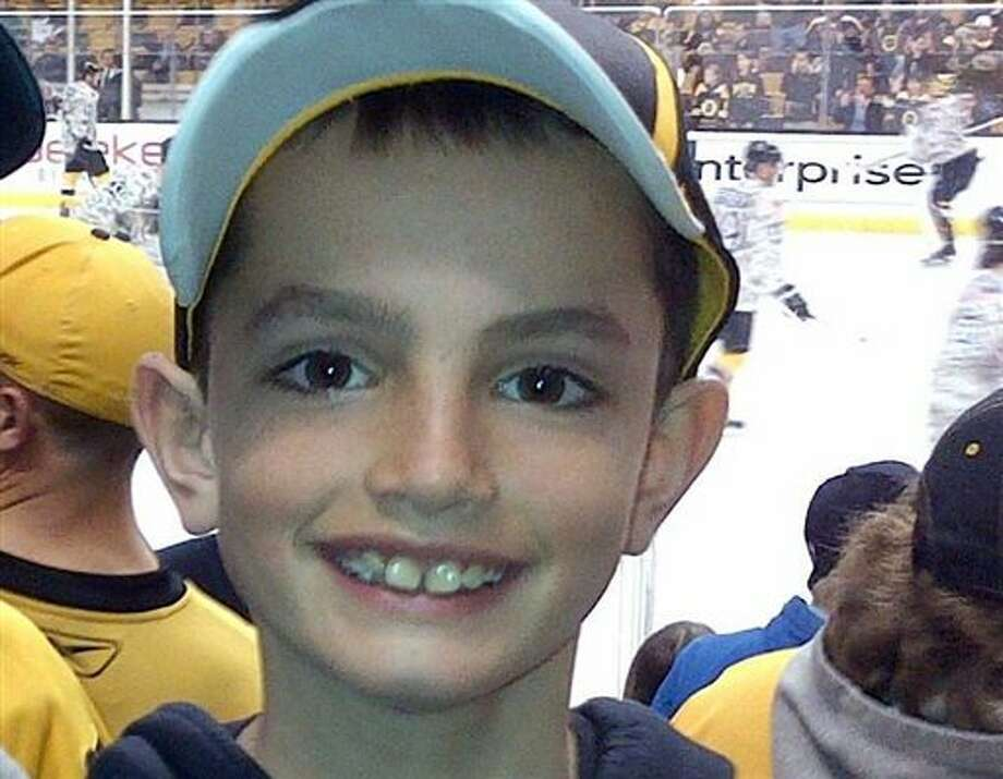 This undated photo provided by Bill Richard shows his son, Martin Richard, in Boston. Martin Richard, 8, was among the at least three people killed in the explosions at the finish line of the Boston Marathon Monday, April 15, 2013. (AP Photo/Bill Richard) Photo: STR / Bill Richard