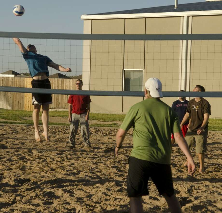 The young professionals group at Stonegate Fellowship gather Saturday evening for a BQ and sand volleyball match. Photo by Tim Fischer/Midland Reporter-Telegram Photo: Tim Fischer