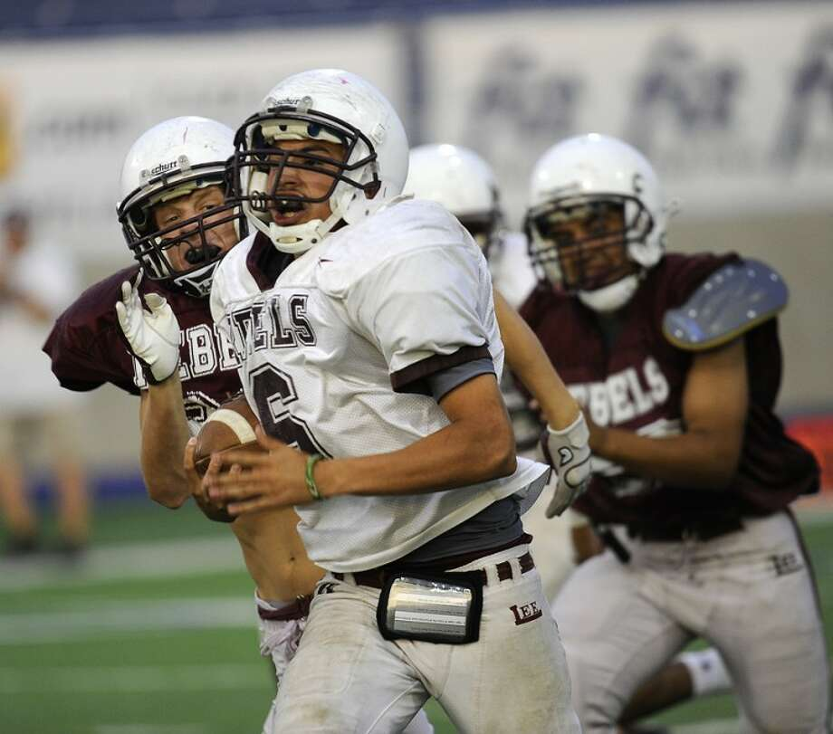 White quarterback Abel Sanchez (6) takes a quarterback keeper for a touchdown in the Maron/White game Friday night at Grande Stadium. The Maroon team came from behind to win the game 24-19. Photo: Wade H Clay
