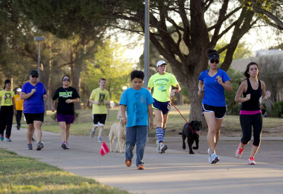 "Runners participate in a ""Run for Boston"" event Wednesday at Midland College. The event raised more than $700 for the Red Cross. James Durbin/Reporter-Telegram Photo: JAMES DURBIN"
