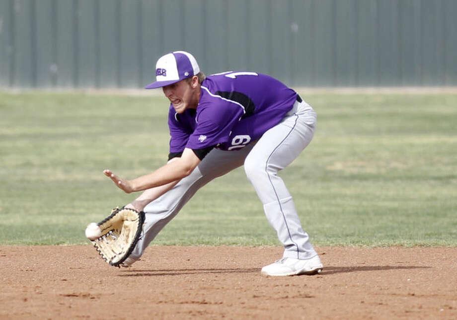 Midland's Jackson Lancaster scoops up a grounder from Abilene Cooper Tuesday at Zachery Field. James Durbin/Reporter-Telegram Photo: JAMES DURBIN