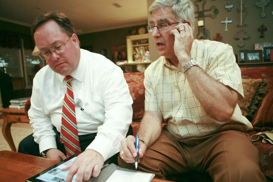 11th Court of Appeals, Place 2 candidate Mike Willson, left, and his business partner Terry Rhoads check on primary voting results Tuesday at Rhoads' home in Midland. Cindeka Nealy/Reporter-Telegram Photo: Cindeka Nealy