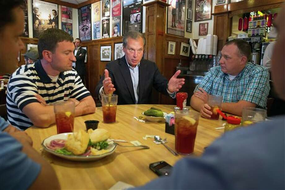 U.S. Senate candidate David Dewhurst, center, visits with diners at Kenny & Ziggy's New York Delicatessen Restaurant on Tuesday, May 29, 2012, in Houston. (AP Photo/ Houston Chronicle, Smiley N. Pool) Photo: Smiley N. Pool / © 2012  Houston Chronicle