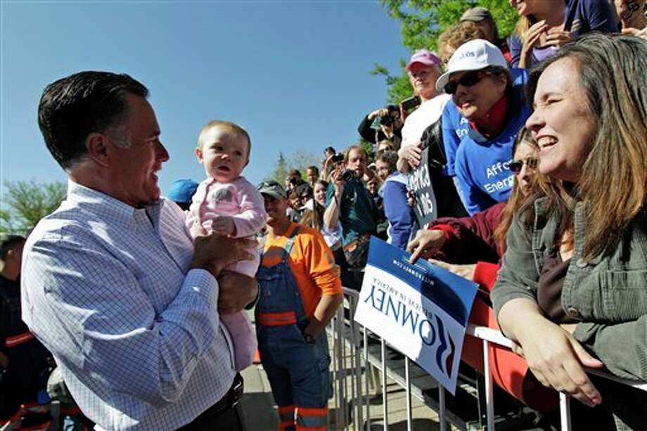 Republican presidential candidate, former Massachusetts Gov. Mitt Romney holds a baby as he greets supporters after speaking at a campaign event, Tuesday, May 29, 2012, in Craig, Colo.  Photo: Mary Altaffer / AP2012