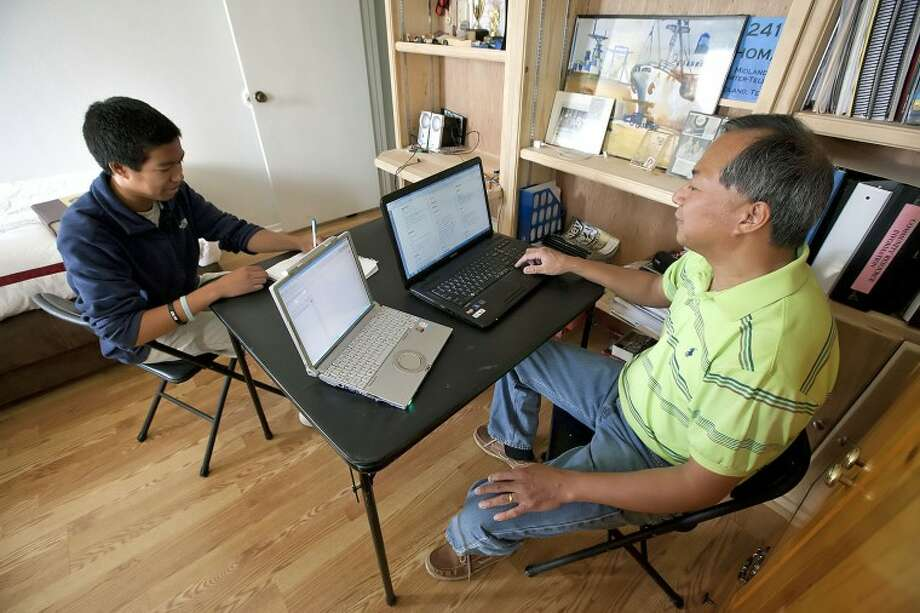Thomas Rubio, 14, writes down the correct spelling of a word as his dad Abner reads them off. Rubio is preparing to compete in the May 29-June 1 National Spelling Bee in Washington D.C. Cindeka Nealy/Reporter-Telegram Photo: Cindeka Nealy