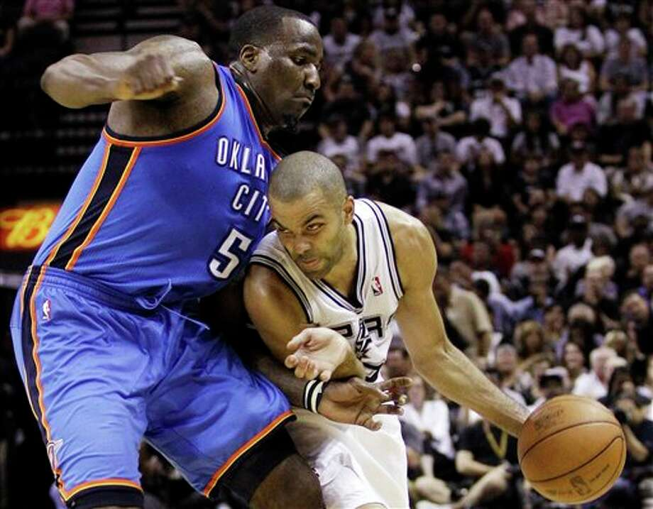 San Antonio Spurs' Tony Parker (9), of France, maneuvers around Oklahoma City Thunder center Kendrick Perkins (5) during the first half of Game 2 in their NBA basketball Western Conference finals playoff series, Tuesday, May 29, 2012, in San Antonio. (AP Photo/Eric Gay) Photo: Eric Gay / AP