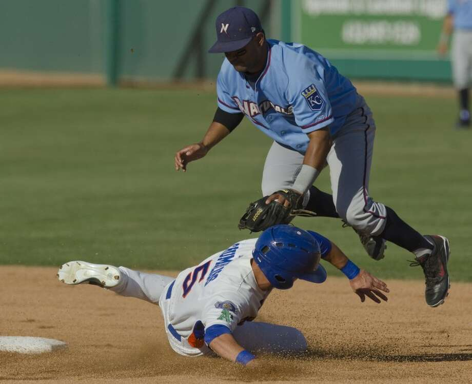 Midland Rockhounds' Conner Crumbliss is out at second but takes out the legs of NW Arkansas' Christian Colon's legs so he can't turn a double play Wednesday evening at CitiBank Ballpark. Photo by Tim Fischer/Midland Reporter-Telegram Photo: Tim Fischer