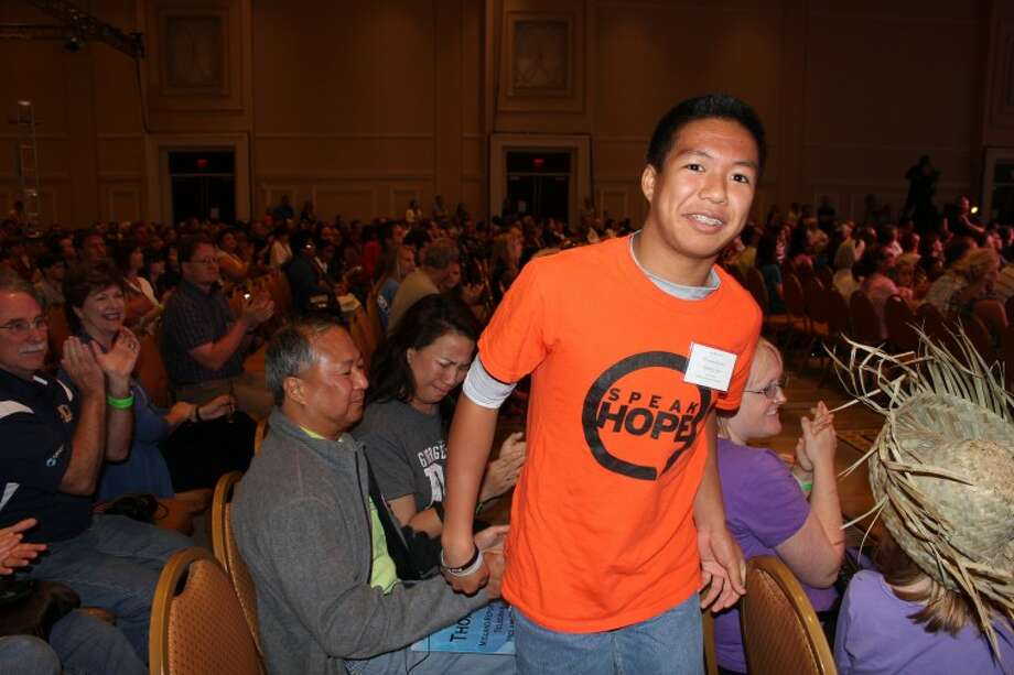 Meredith Moriak/Reporter-Telegram Alamo Jr. High's Thomas Rubio smiles as he heads to join the 50 other semifinalists on stage at the 2012 Scripps National Spelling Bee in National Harbor, Md. As a second year competitior, Rubio scored higher than at least 228 other spellers during three preliminary rounds to earn a spot in the semifinals.