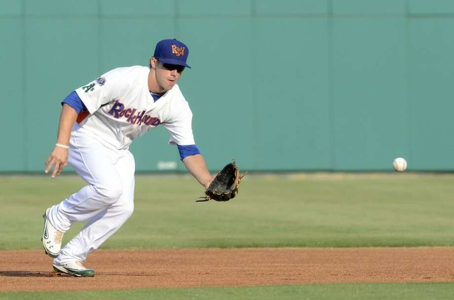 RockHounds short-stop Dusty Coleman prepares to catch the ball and make the play at first Thursday during the RockHounds game against the Naturals at Citibank Ballpark. Cindeka Nealy/Reporter-Telegram Photo: Cindeka Nealy