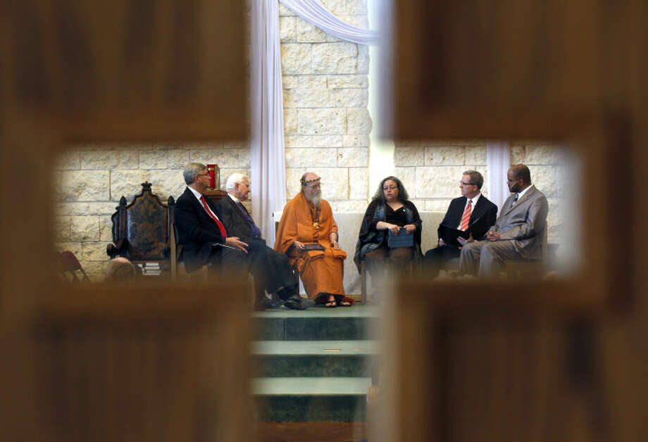 Religious leaders from left, Rev. Randel Everett, pastor of First Baptist Church of Midland, Rev. Sam B. Hulsey, retired bishop of Episcopal Diocese of Northwest Texas, Satguru Bodhinatha Veylanswami of a Hindu Monastery in Kauai, Hawaii, Rabbi Holly Levin Cohn, of the Temple Beth El in Odessa, Jerry Zant, Odessa stake president of The Church of Christ of Latter-day Saints, and Imam Wazir Ali, of Masjid Warithud-Deen Mohammed in Houston, participate in an annual Interfaith Event on Wednesday at St. Nicholas' Episcopal Church. James Durbin/Reporter-Telegram Photo: JAMES DURBIN
