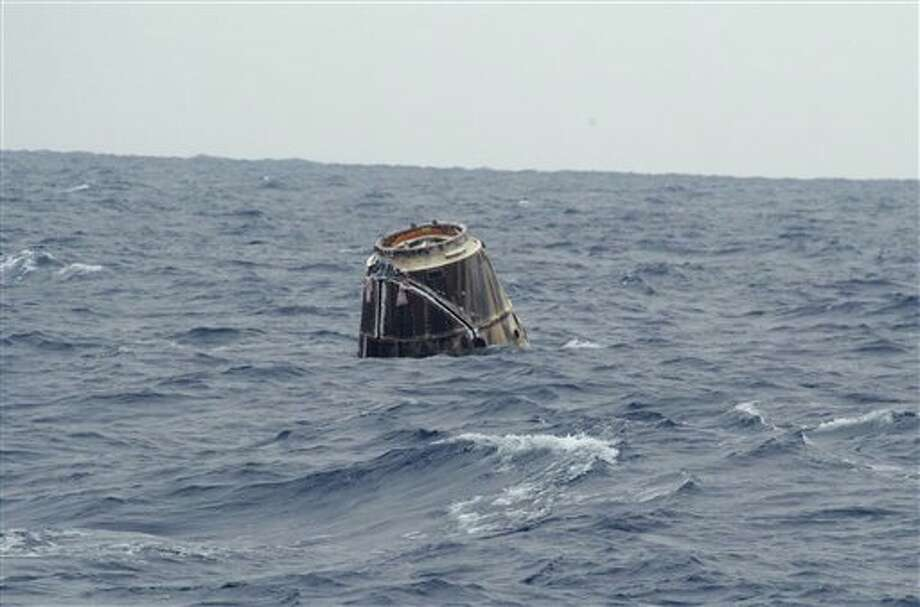 In this photo provided by SpaceX, the Dragon spacecraft floats on the surface of the Pacific Ocean about 500 miles off Mexico's Baja California on Thursday, May 31, 2012 after its mission to the International Space Station. (AP Photo/SpaceX, Michael Altenhofen) Photo: Michael Altenhofen / SpaceX