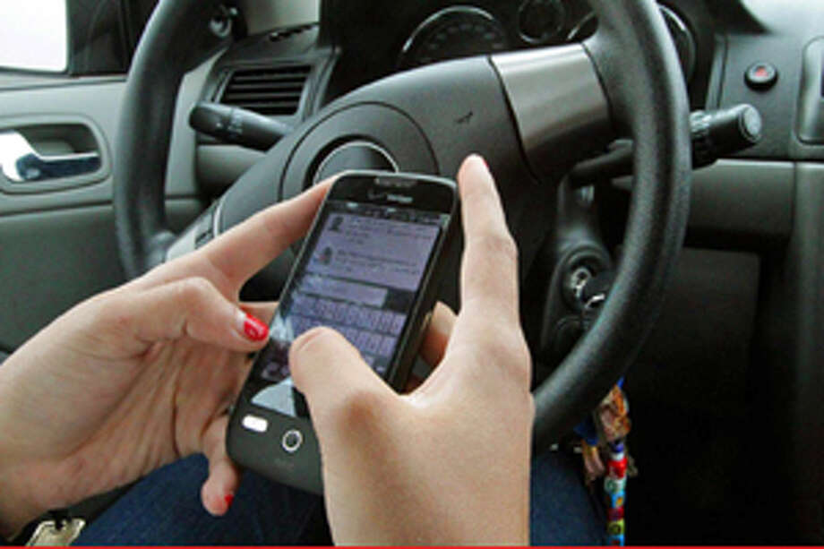 Text messaging behind the wheel illustration. Photo: Illustration By Rudy Gutierrez/Associated Press