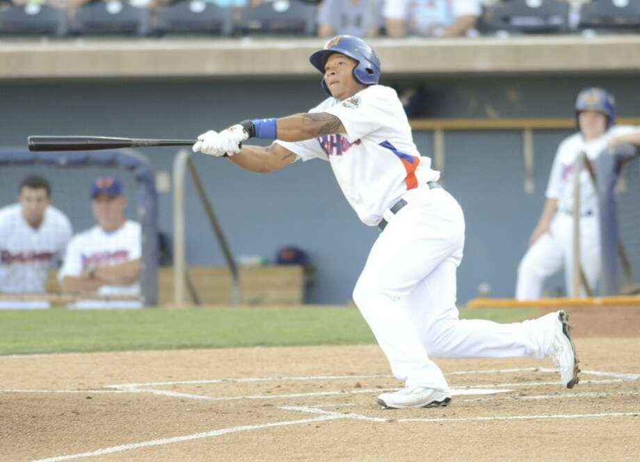 RockHounds center fielder Michael Choice hits a sacrafice fly on June 1 during their game against the Northwest Arkansas Naturals at Citibank Ballpark. Cindeka Nealy/Reporter-Telegram Photo: Cindeka Nealy