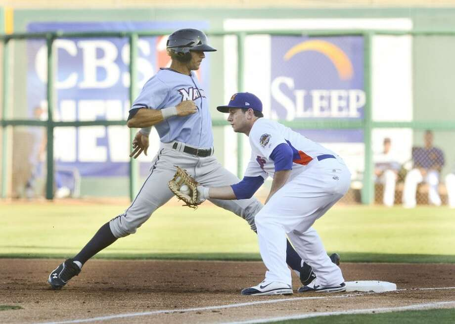 RockHounds first baseman Anthony Aliotti attempts to pick off Paulo Orlando earlier this season during their game at Citibank Ballpark. Cindeka Nealy/Reporter-Telegram Photo: Cindeka Nealy