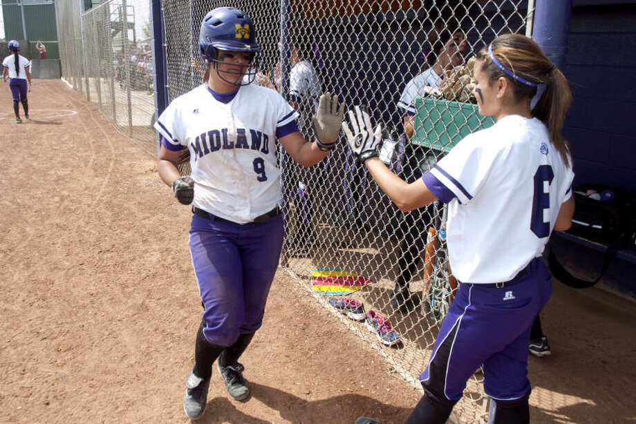 Midland High senior Lexi Lopez, left, was a first team selection as an infielder on this year's 2-5A All-District team. James Durbin/Reporter-Telegram Photo: JAMES DURBIN