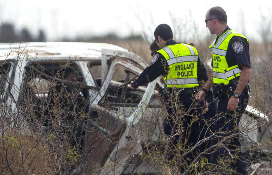 Midland emergency personnel responded to a fatal rollover accident on the 250 Loop and Cynthia Drive Saturday. James Durbin/Reporter-Telegram Photo: JAMES DURBIN