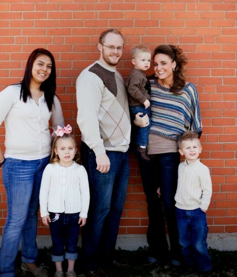 Tyler and Alicia Press stand with their children, three of whom are adopted. The presses went from having no children to having four in two years and all before they've turned 30. (From left) Crystal, 17; Emily, 6; Tyler, 29; Pierceton, 2; Alicia, 28; and Jaden, 4.