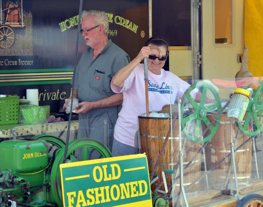 "Jay Chancey and his wife Jean Jackson make homemade ice cream and root beer floats with a 1929 John Deere ""Hit & Miss"" engine at the Old Sorehead Trade Days Saturday afternoon. Photo: James Cannon/MRT"