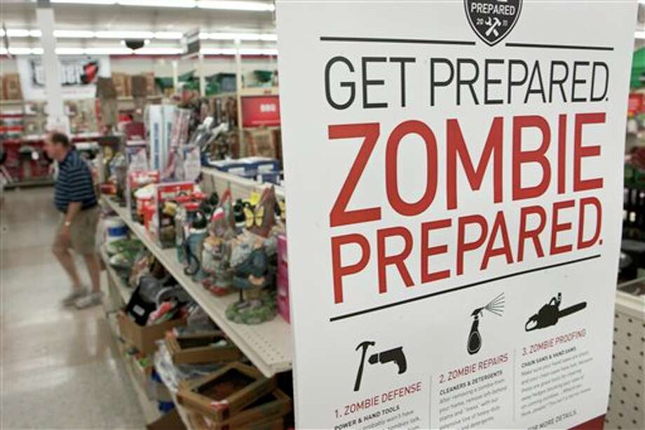 FILE - In this Monday, Oct. 10, 2011 file photo, a sign promoting zombie preparedness displays in a hardware store in Omaha, Neb. After several gory incidents that have been reported around the country recently, online zombie talk has grown. (AP Photo/Nati Harnik, File) Photo: Nati Harnik