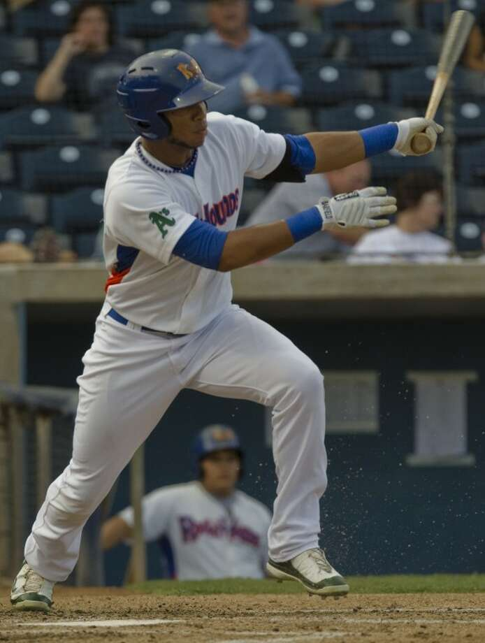 RockHounds' Jeremy Barfield watches his shot back up the middle earlier this year at Citibank Ballpark. Photo by Tim Fischer/Midland Reporter-Telegram Photo: Tim Fischer