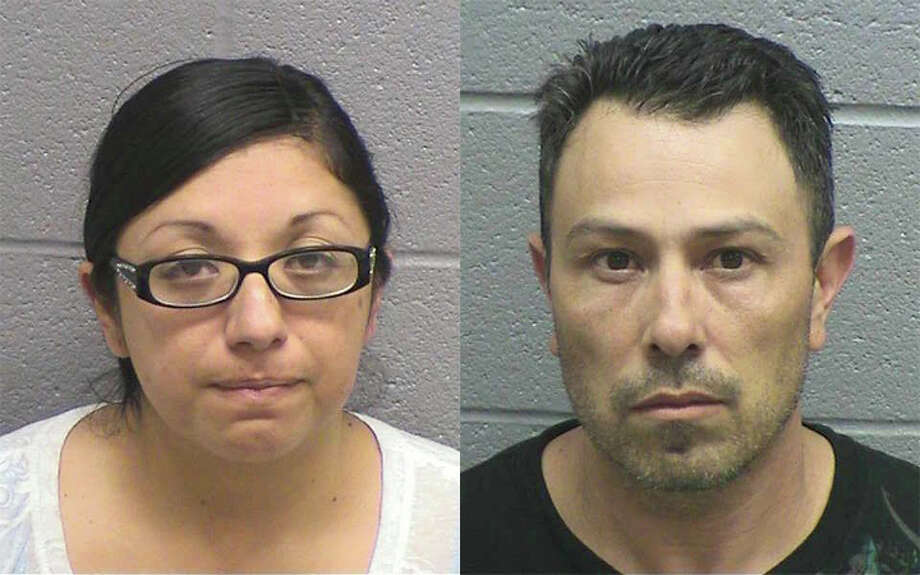 Clare (left) and Jerry Flores were arrested for theft on May 30, 2012. The couple is accused of swindling another couple in a Cragislist rent-to-own scam.