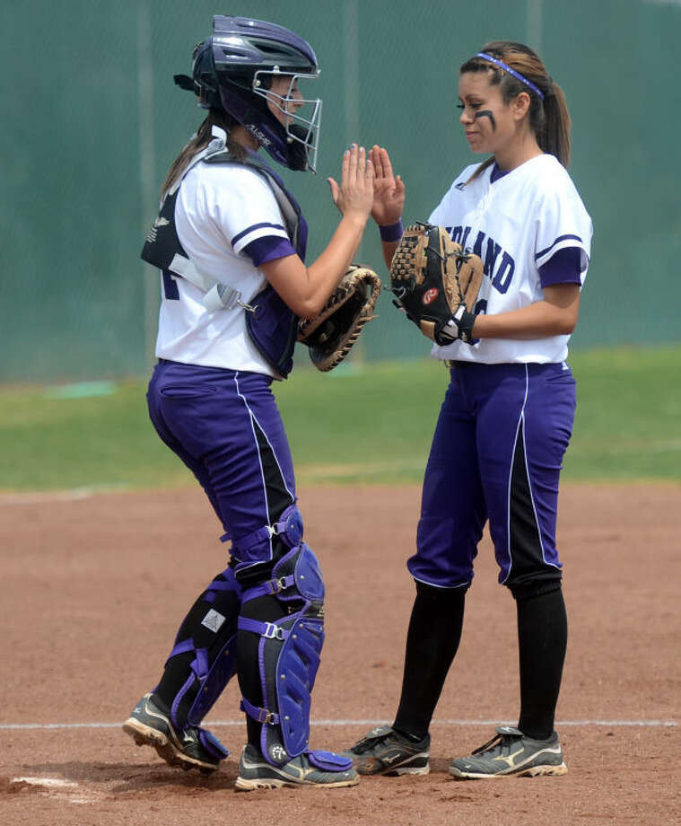 Midland High pitcher Stefani Baeza and catcher Courtney Warren high five before starting off an inning against Lee High Saturday at Audrey Gill Sports Complex. James Durbin/Reporter-Telegram Photo: JAMES DURBIN