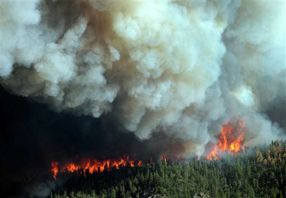 In this Saturday, June 9, 2012 photo, flames burn in the area near Larimer County Road 27 and Colorado Highway 14 of the High Park fire west of Fort Collins, Colo. (AP Photo/The Denver Post, Karl Gehring) MAGS OUT; TV OUT; INTERNET OUT Photo: Karl Gehring / The Denver Post