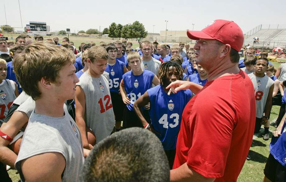 Football University participants gather around and listen as Head Coach Glen Smith talks to the players about what is expected of them during camp Saturday at Greenwood High School in June. The camp is one of the few of its kind in West Texas. Cindeka Nealy/Reporter-Telegram Photo: Cindeka Nealy
