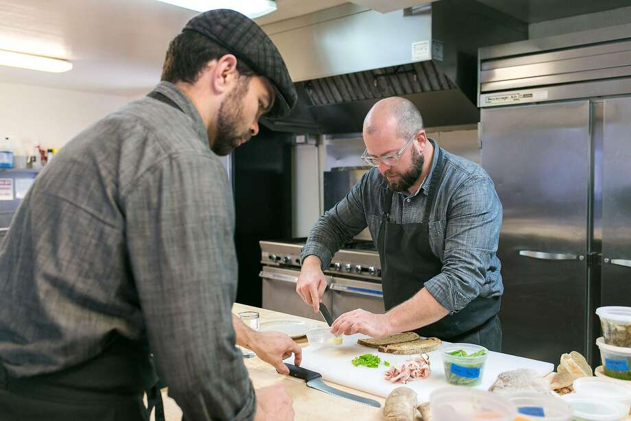 Kevin Folan (left) and Ryan Harris make sandwiches for Contimo Provisions in Napa. Photo: Jen Fedrizzi, Special To The Chronicle