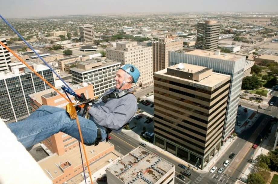Mayor Wes Perry begins to rappel from the roof of the 22-floor Wilco Building during last year's Over the Edge event to benefit the Buffalo Trail Council of the Boy Scouts of America. Photo: Cindeka Nealy/Reporter-Telegram