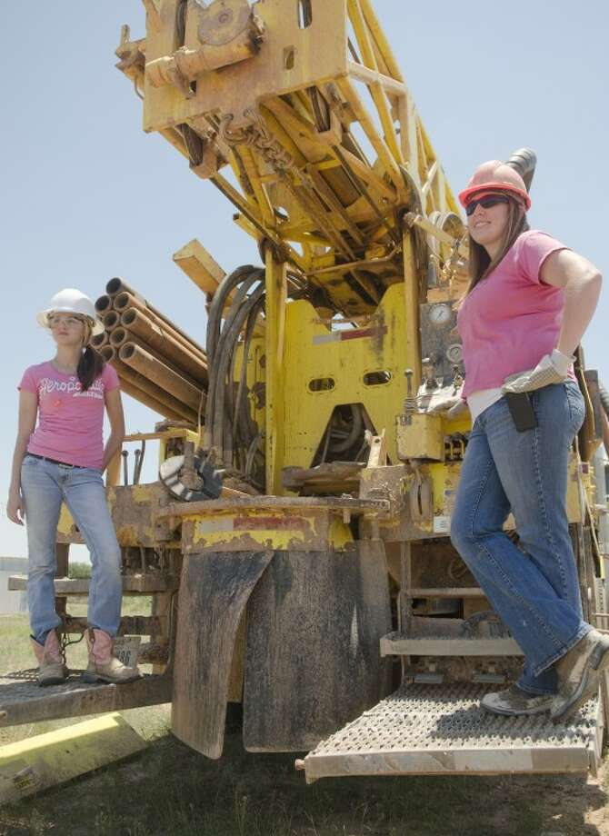 Dara Crass, right, vp of Darrell Crass Drilling Co. and her niece Skylar Stone, man one of the drilling rigs. Photo by Tim Fischer/Midland Reporter-Telegram Photo: Tim Fischer
