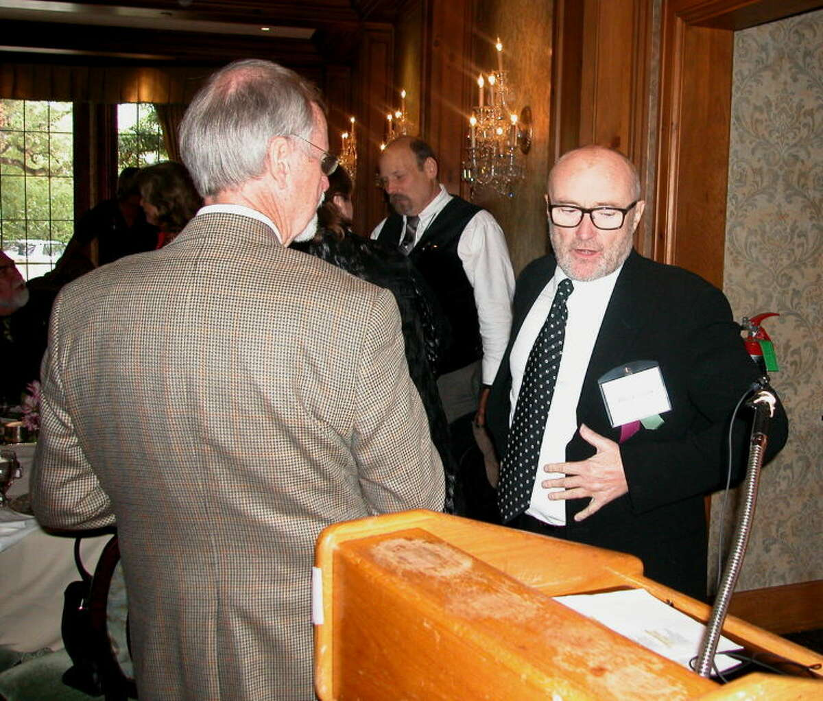 """Singer Phil Collins, right, was among authors who were honored by the San Antonio Conservation at a luncheon Friday in San Antonio. Collins' book, """"The Alamo and Beyond: A Collector's Journey,"""" was published March 6, 2012 -- the 176th anniversary of the day the Alamo fell."""