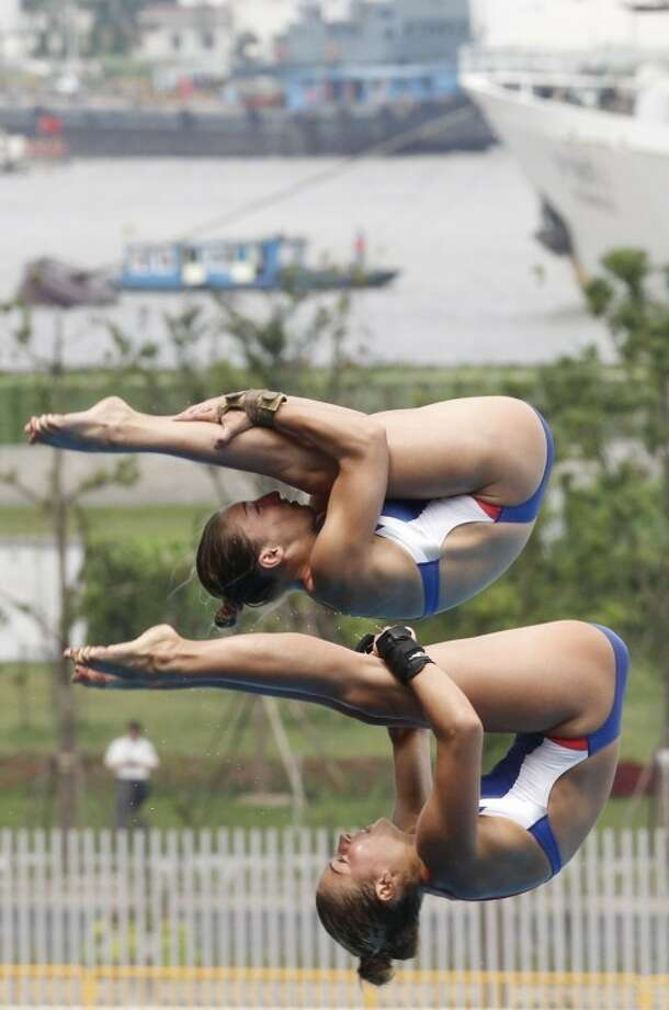 Midlander Anna James and Mary Beth Dunnichay of the U.S. dive during the women's 10-meter Synchro Platform event at the FINA Swimming World Championships in Shanghai, China on Monday. The two finished 11th in the finals out of 12 competitors. (AP Photo/Wong Maye-E) Photo: Wong Maye-E