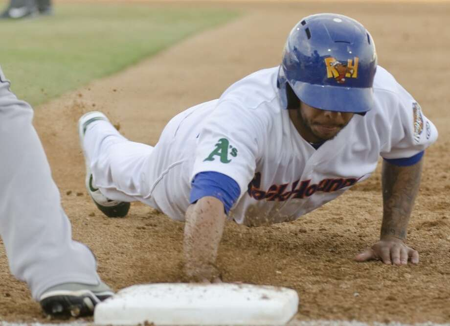 RockHounds' Tyler Ladendorf beats the throw back to first on a pickoff attempt earlier this season against the Corpus Christi Hooks. Photo by Tim Fischer/Midland Reporter-Telegram Photo: Tim Fischer
