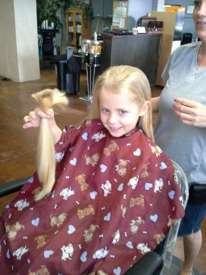 Addie Roundtree on Thursday donated a foot of her hair to Locks of Love. The daughter of Allen and Marla Roundtree had her hair cut as a way to celebrate her fifth birthday, which is July 10, her mom said. Addie will be a kindergartner at Bush Elementary School.