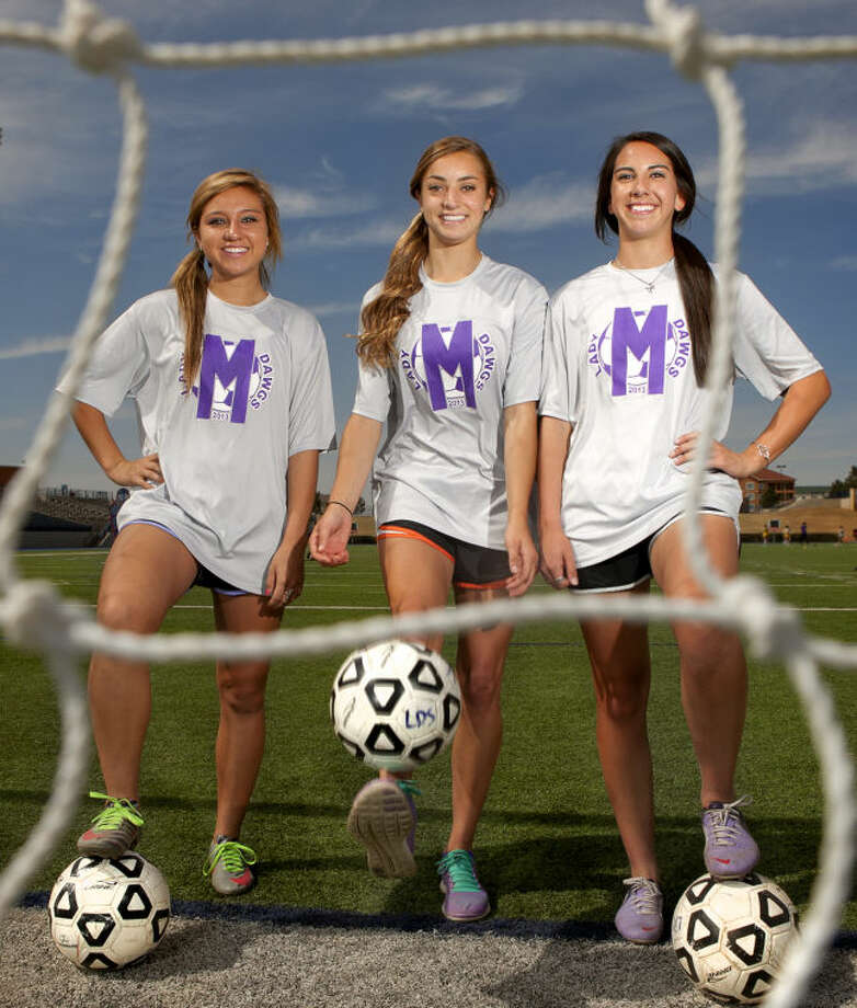 Midland High soccer defenders from left, Megan Martin, Channing Harrell, and Megan Hoppel pose for a portrait Wednesday at Grande Communications Stadium. James Durbin/Reporter-Telegram Photo: JAMES DURBIN