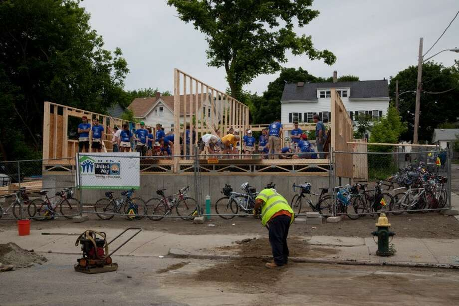 Bike and Build participants work with Habitat for Humanity on a house in Providence, R.I. before beginning a cross-country trip. Photo: Trish Burdett