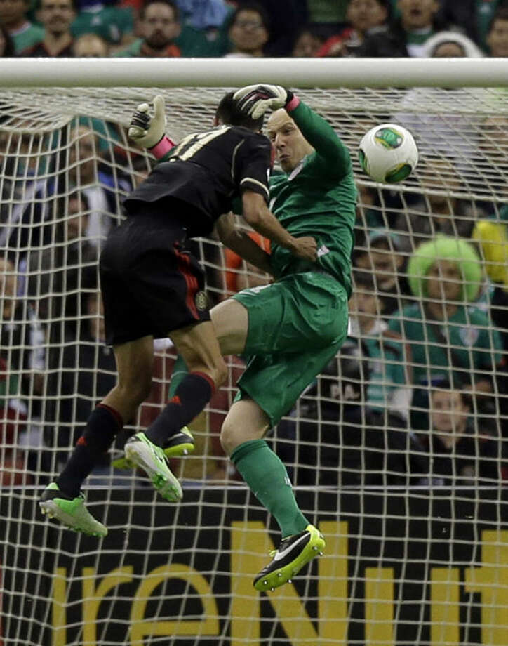 Mexico's Jesus Zabala, left, collides with United States goalkeeper Brad Guzan while trying to score during a 2014 World Cup qualifying match at the Aztec stadium in Mexico City, Tuesday, March 26, 2013. (AP Photo/Eduardo Verdugo) Photo: Eduardo Verdugo
