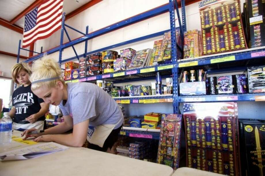 Brittney Heifner, right, and her sister Brylie check the stock and create price tags for new items at the Truckload Fireworks warehouse near the intersection of SH191 and CR 1275  in preparation for 2010 Independence Day celebrations.