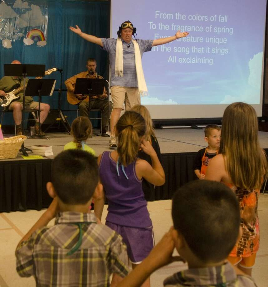 Kelly Inman, assistant pastor with St. Luke's United Methodist Church, leads vacation Bible school children in worship songs June 5, in the Fellowship Hall. Photo by Tim Fischer/Midland Reporter-Telegram Photo: Tim Fischer