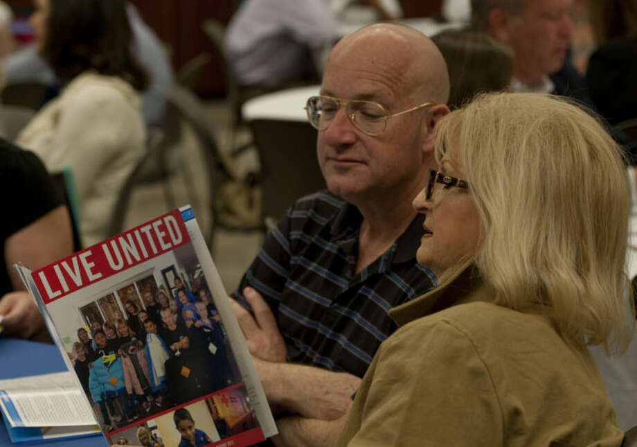 Preston Chancellor and Judy Warren look over the United Way annual report for 2012 Wednesday at the celebration luncheon. Tim Fischer\Reporter-Telegram Photo: Tim Fischer